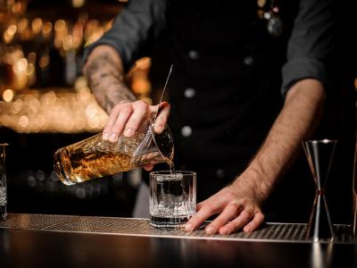 Bartender pouring a cocktail at a Natural Bridge bar